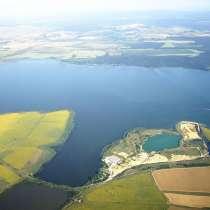 Продаю большой участок с видом на озеро Мандра, в г.Варшава