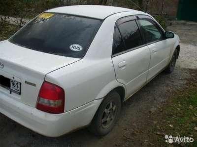 подержанный автомобиль Mazda Фамилия
