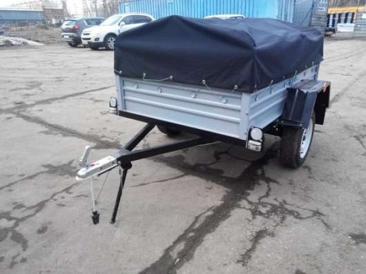Прицеп для легкового автомобиля с V образным дышлом 1800х1250 с тентом и дугами в Москве Фото 1
