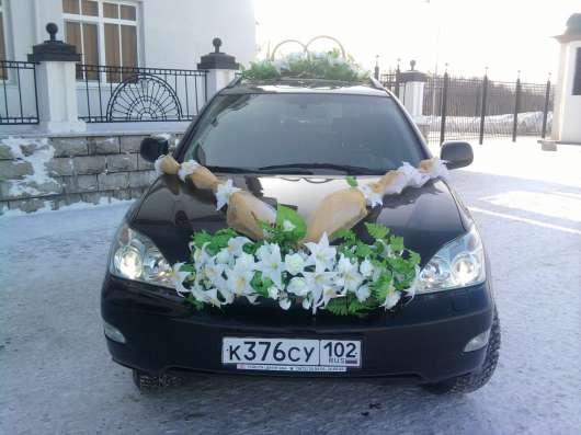 Свадебные украшения в Уфе, Кольца букеты для машин Фото 4